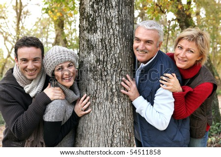 Portrait of men and women smiling in the countryside - stock photo