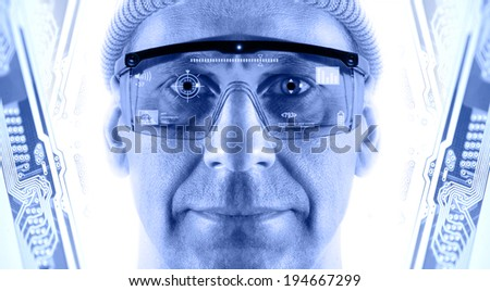 Portrait of men in smart glasses on a electronic circuit board background. Toned blue. - stock photo