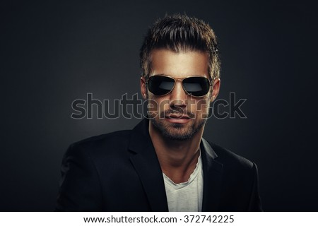 Portrait of men with sunglasses - stock photo