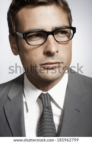 Portrait of mid adult businessman - stock photo
