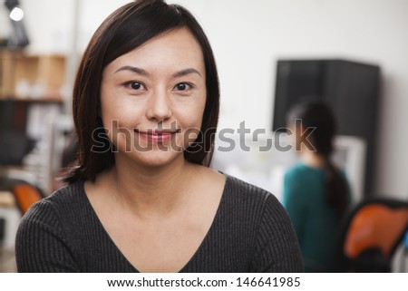 Portrait of mid adult businesswoman in the office - stock photo