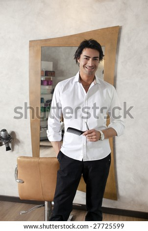 portrait of mid adult hairstylist looking at camera - stock photo