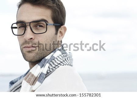 Portrait of mid adult man wearing scarf and spectacles