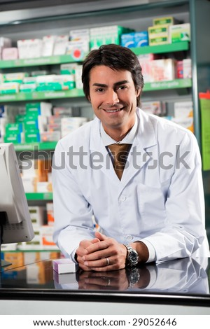 portrait of mid adult pharmacist looking at camera - stock photo