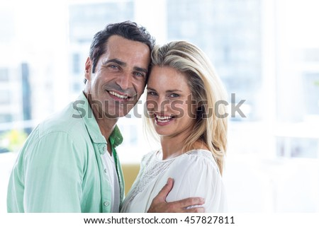 Portrait of mid adult romantic couple at home