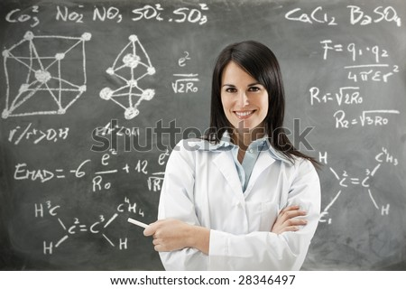 portrait of mid adult teacher looking at camera - stock photo
