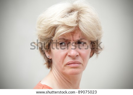 Portrait of mid adult woman in bad mood - stock photo