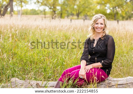 Portrait of middle age caucasian female in Autumn. - stock photo