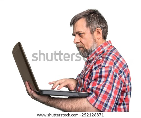 Portrait Of middle aged businessman holding laptop isolated on white background - stock photo