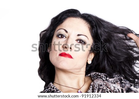 Portrait of middle-aged caucasian woman with long hair, on white background.