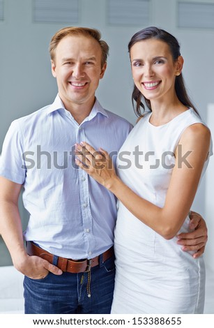 Portrait of middle aged couple looking at camera