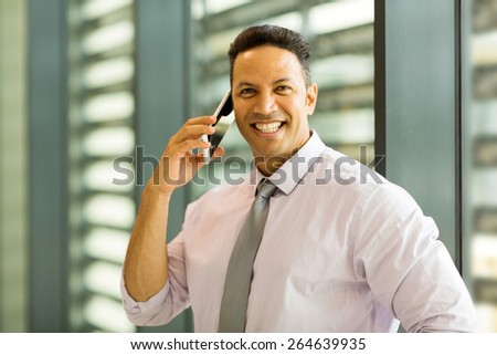 portrait of middle aged entrepreneur talking on mobile phone - stock photo