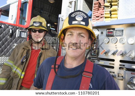 Portrait of middle aged firefighters - stock photo