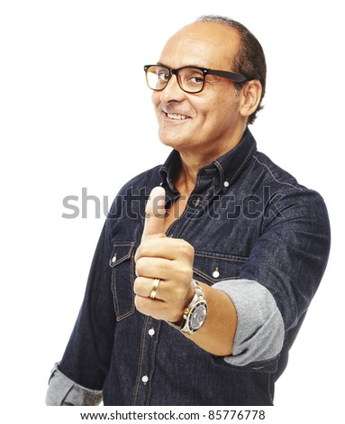 portrait of middle aged man doing good symbol against a white background - stock photo