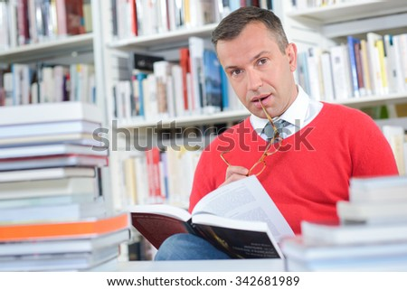 Portrait of middle aged man in library - stock photo