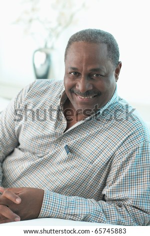 Portrait of middle-aged man smiling - stock photo