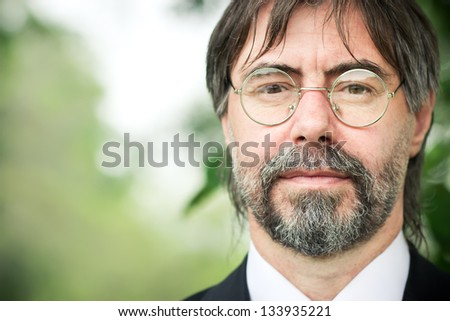 portrait of middle-aged man with glasses, looking at camera. - copyspace - stock photo