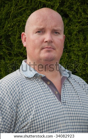 portrait of middle aged over weight man - stock photo