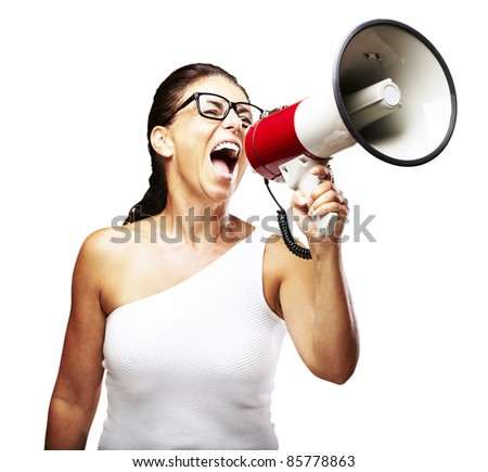 portrait of middle aged woman shouting using megaphone over white background - stock photo