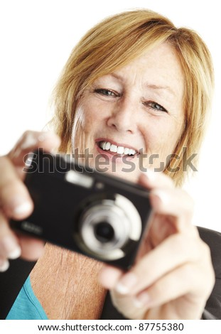 portrait of middle aged woman taking photo over white background - stock photo