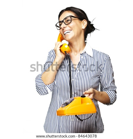 portrait of middle aged woman wearing glasses with vintage telephone on white background - stock photo