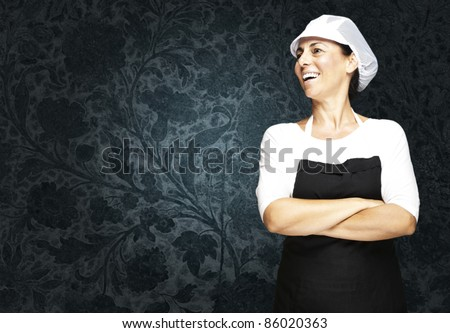 portrait of middle aged woman with apron and mesh top hat against a vintage background - stock photo