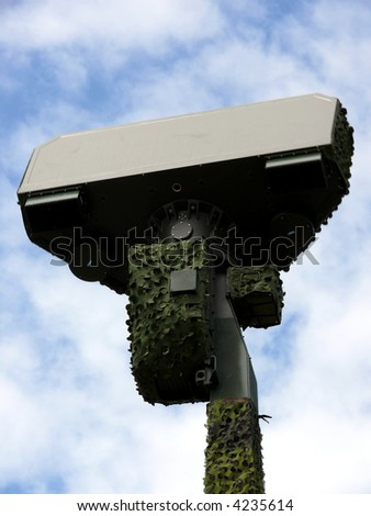 portrait of military radar in blue sky - stock photo