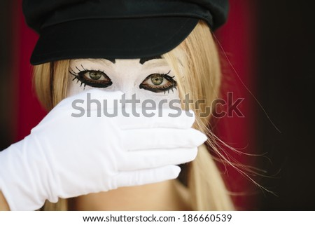 portrait of mime with black hat and white gloves - stock photo