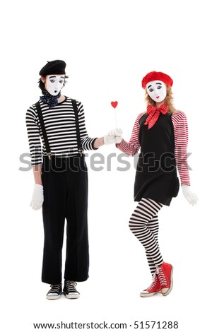 portrait of mimes. man giving small red heart to young woman. isolated on white background - stock photo
