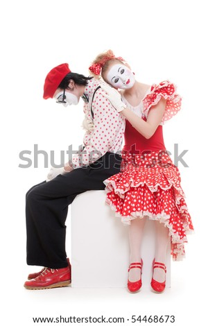 portrait of mimes siting on the cube. isolated on white background - stock photo