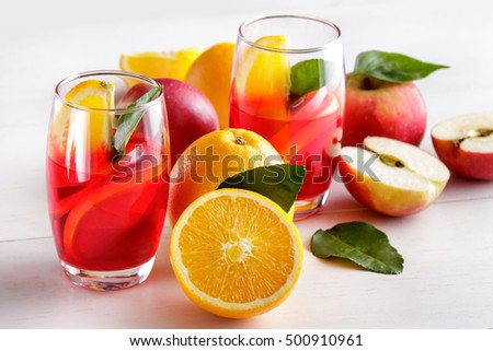 portrait of mix syrup with orange and apple slice isolated on white background
