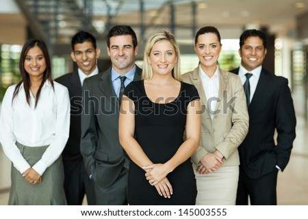 portrait of modern business team inside office building - stock photo