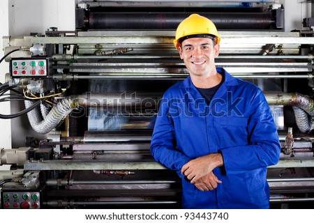 portrait of modern printing press operator in factory - stock photo