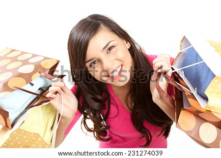 Portrait of modern shopper looking at camera with smile  - stock photo