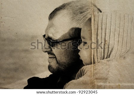 portrait of 10 month old girl and dad. Focus on the child.  Photo in old image style. - stock photo
