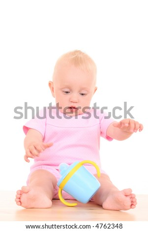 portrait of 10 months baby girl with baby cup isolated on white