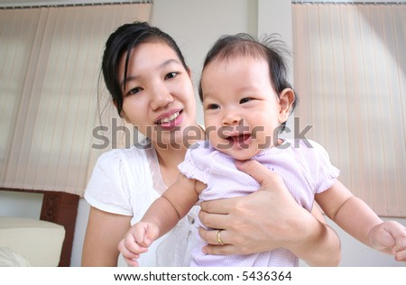Portrait of mother and baby