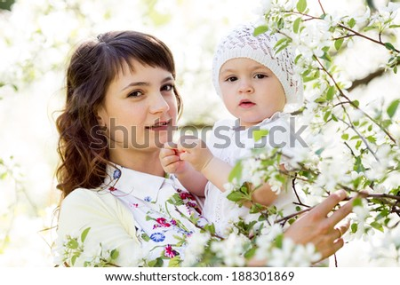 portrait of mother and baby girl outdoors - stock photo