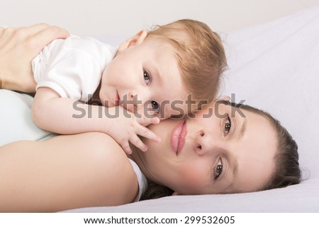 Portrait of mother and child laughing  - stock photo