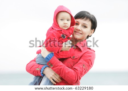 portrait of mother and child outdoors - stock photo