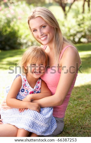 Portrait Of Mother And Child Relaxing In Park - stock photo