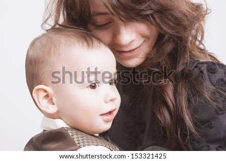 Portrait of Mother and Child together. Over White Background. Horizontal Shot