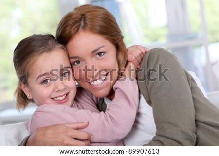 Portrait of mother and daughter at home - stock photo