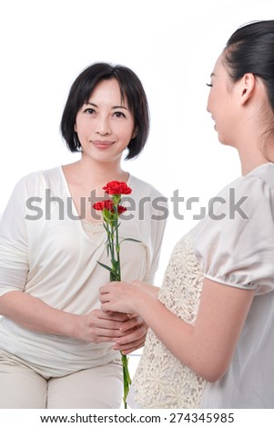 portrait of mother and daughter celebrating mother's day - stock photo