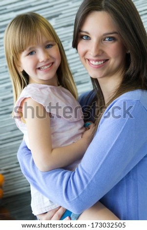 Portrait of Mother and daughter having fun in the kitchen - stock photo