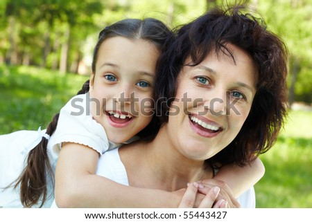 Portrait of mother and daughter having fun on summer day