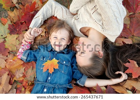 portrait of mother and daughter in nature - stock photo