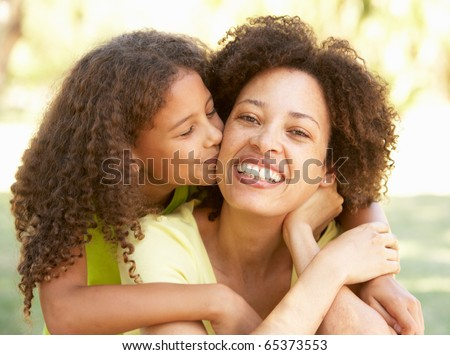 Portrait Of Mother And Daughter In Park - stock photo