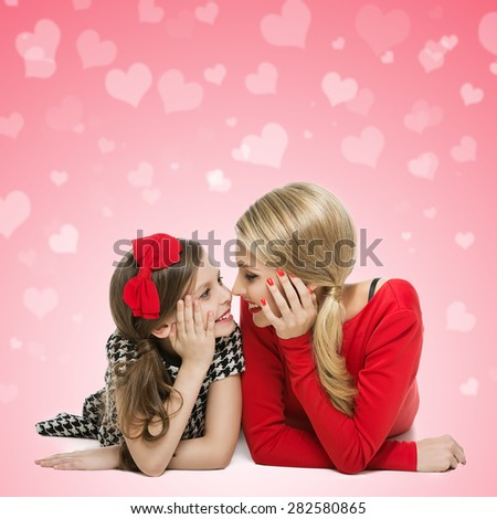 Portrait of mother and daughter lying and looking at each other over pink background with heart bokeh. Isolated. Copy space. - stock photo