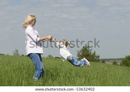 Portrait of mother and daughter on rest - stock photo